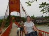 Vang_vieng_biking_over_bridge_michelle_a_1